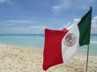 Mexico Flag on Cancun Beach